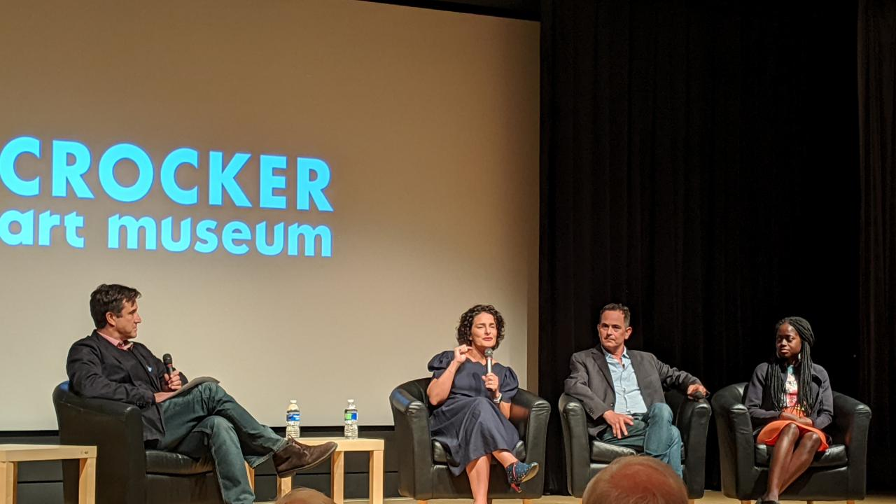Filmmakers and panelists seated onstage in front of Crocker Art Museum logo