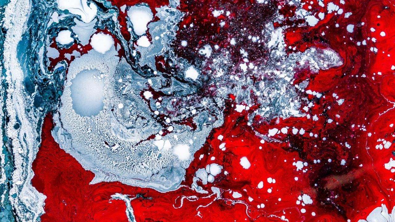 Abstract red and blue-gray paint splotches