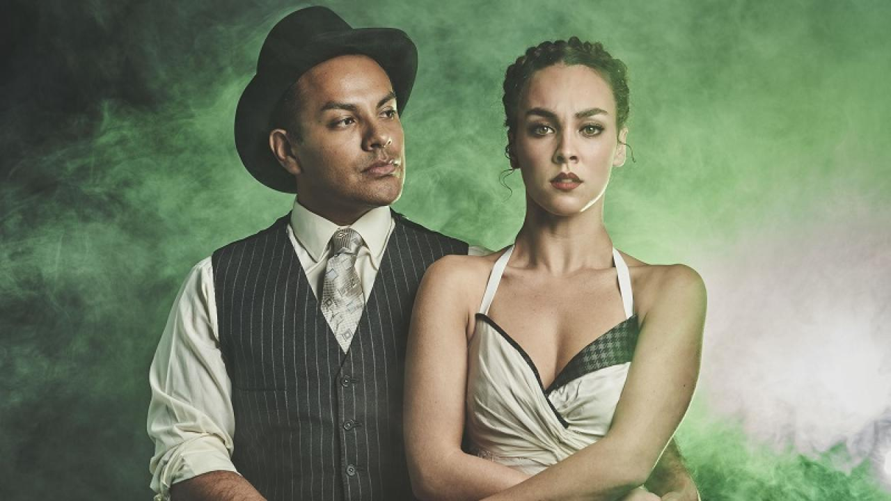 Threepenny Opera actors against green smoky background
