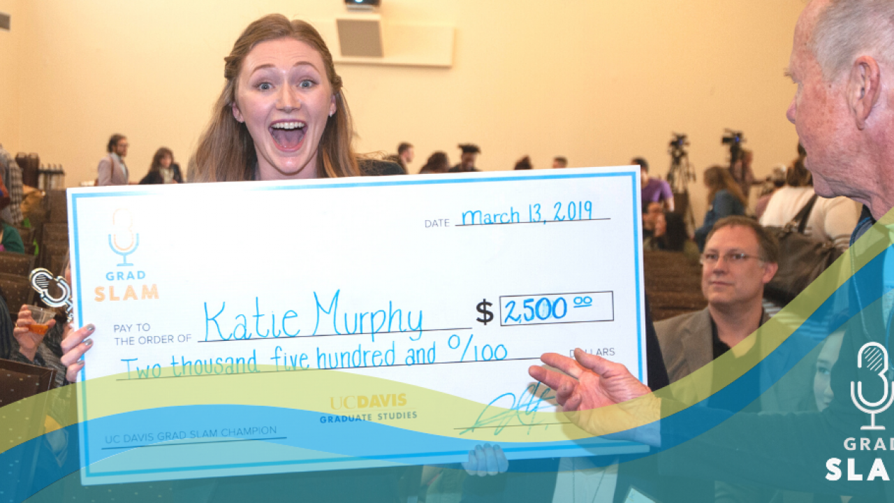 Katie Murphy holding giant check for $2500