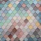 Colorful tile image of blues, yellows, pinks, greens, and reds